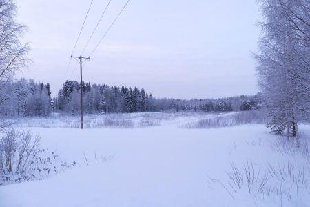 Otanmäen viljelypalstat lumen peitossa